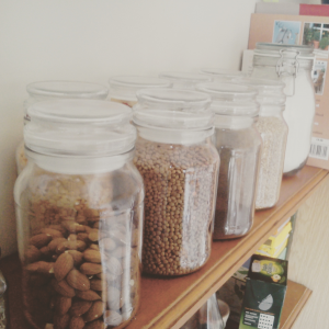I keep many ingredients in these decorative and reusable jars on our kitchen shelf. | (c) Clara del Rey